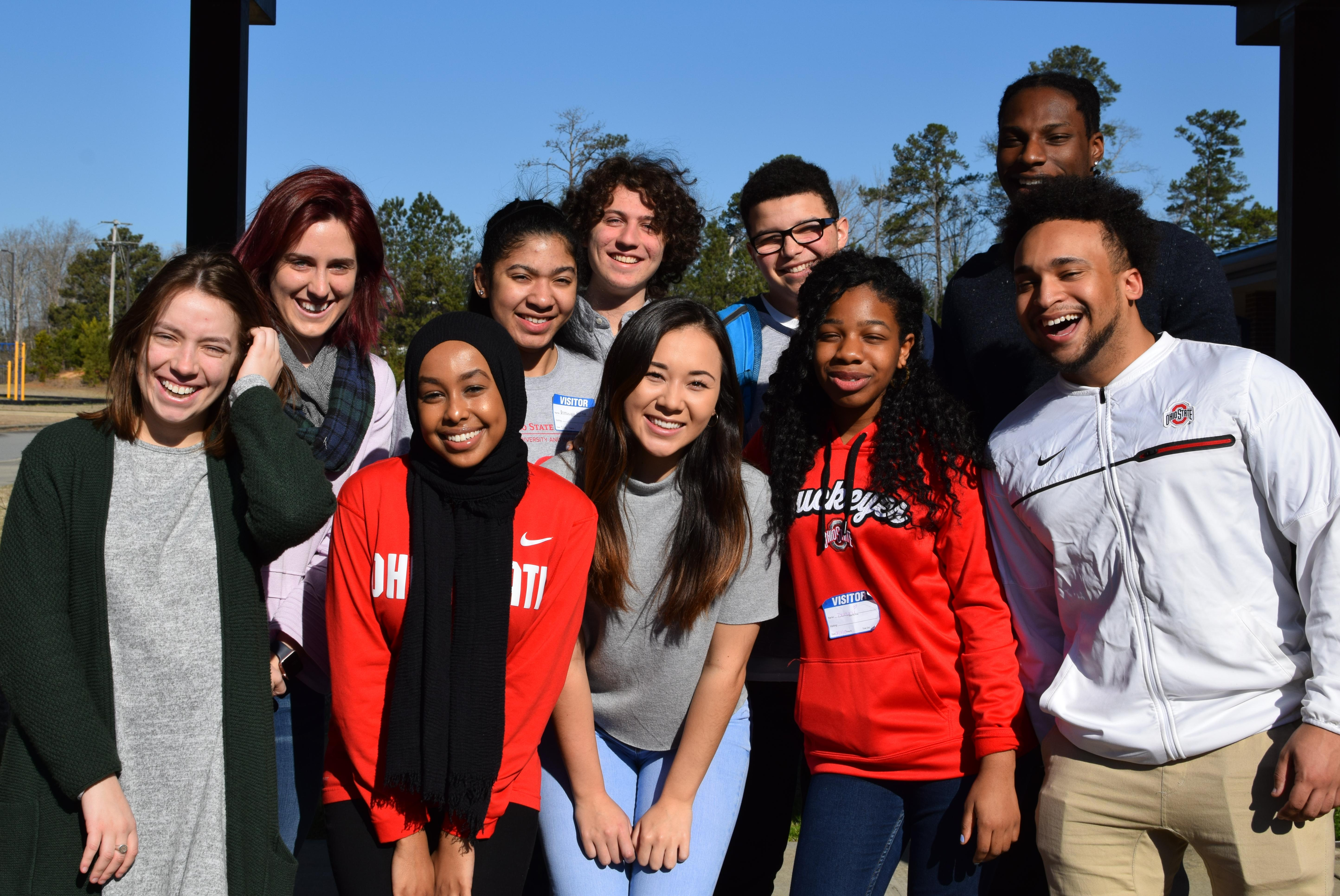 group of MSP students smiling into the camera in the sun