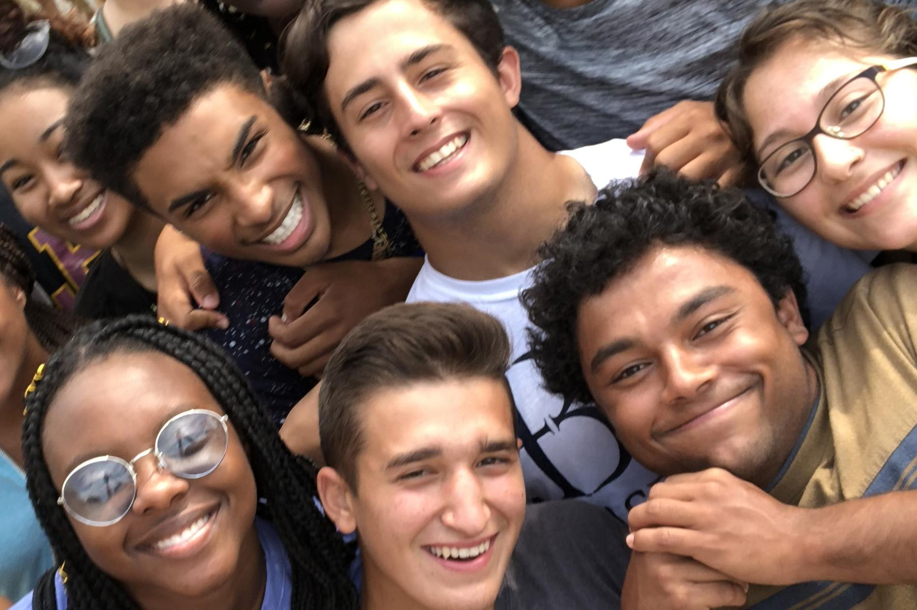 group of smiling kids in selfie