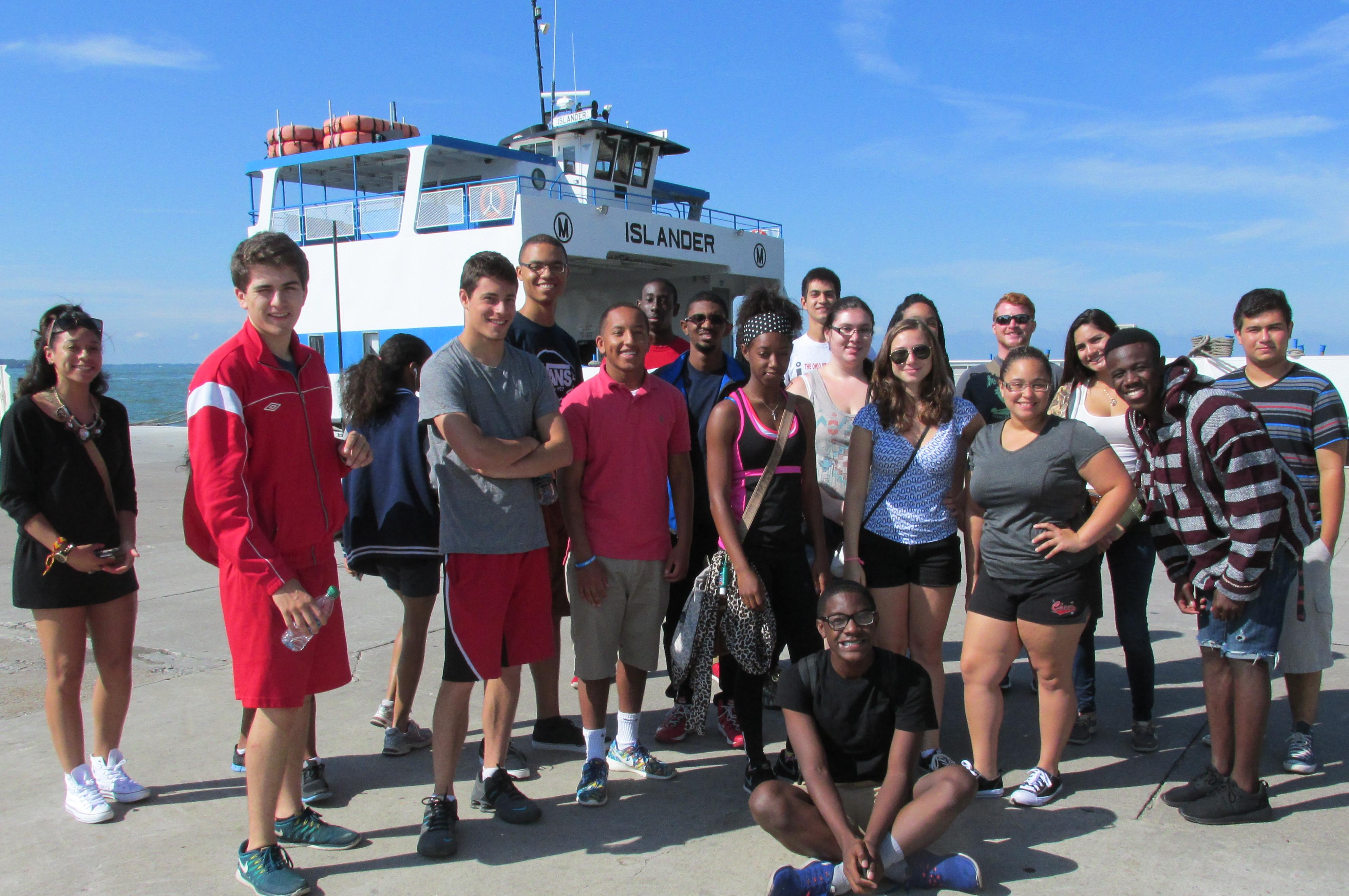 LSAMP Scholars standing in front of a boat on Lake Erie