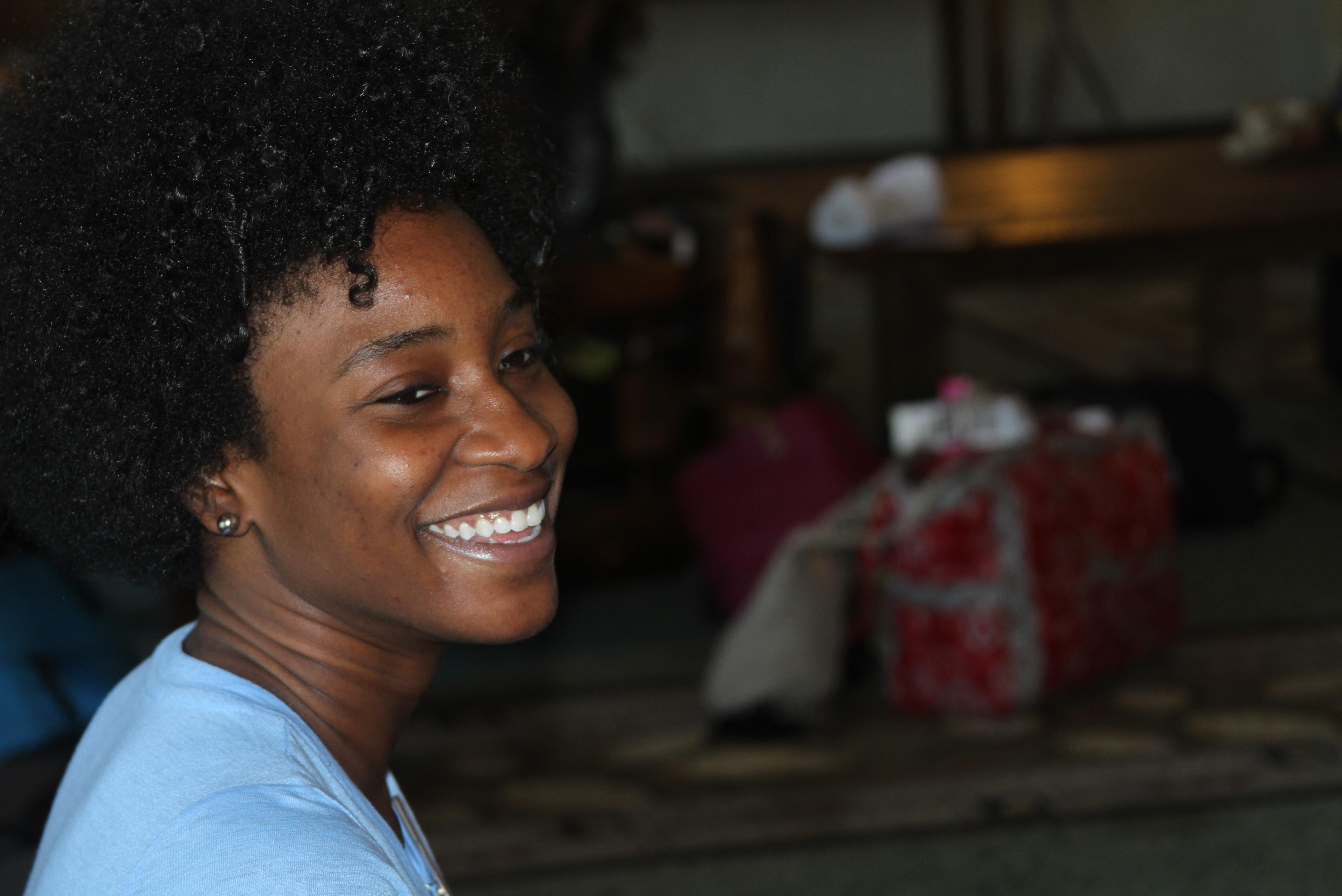 Black woman smiling at camera