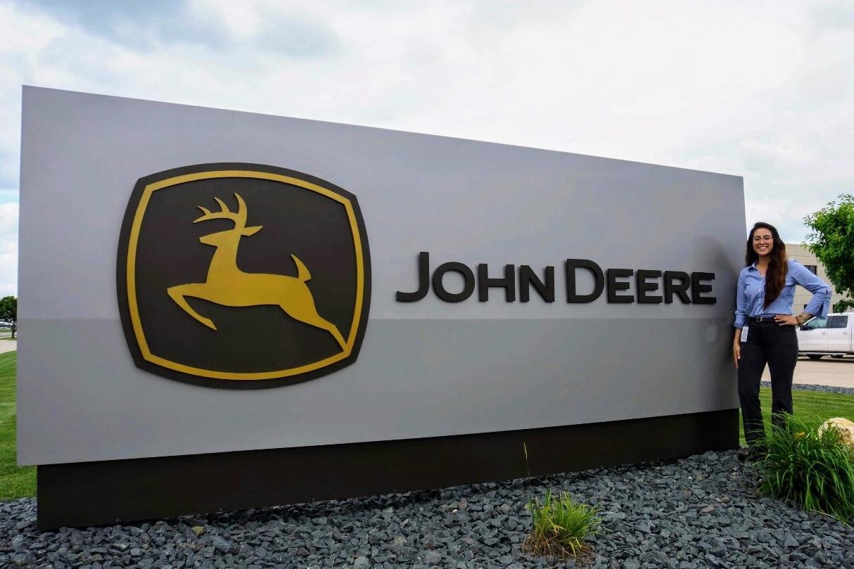 Karen Santos standing in front of a John Deer sign