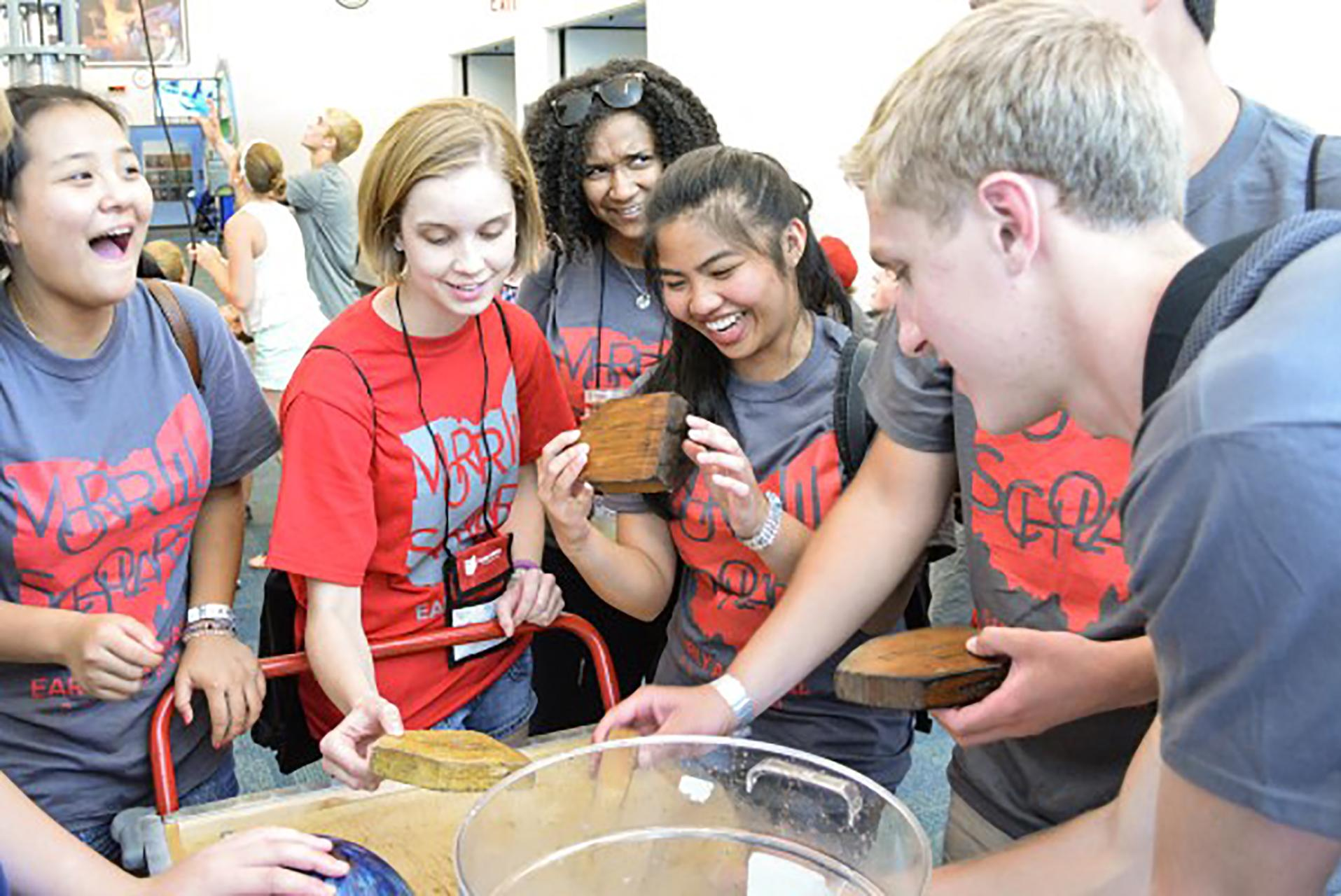 MSP students looking at wood in lab