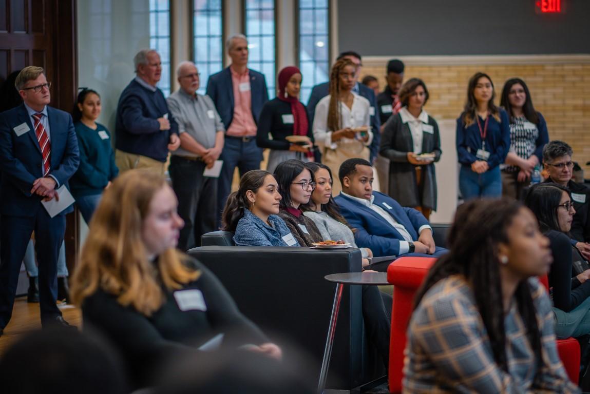 attendees listen to speaker