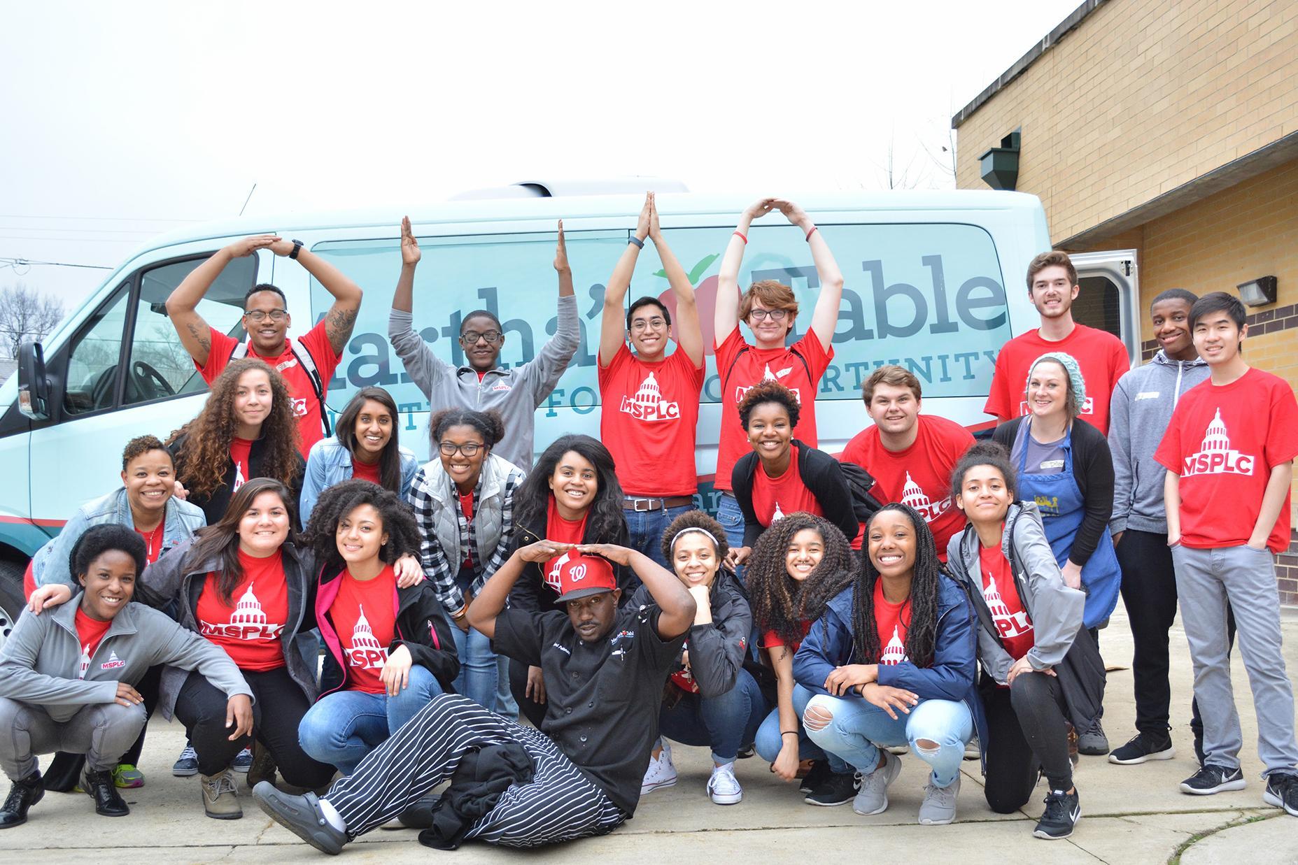 MSP scholars in front of a van