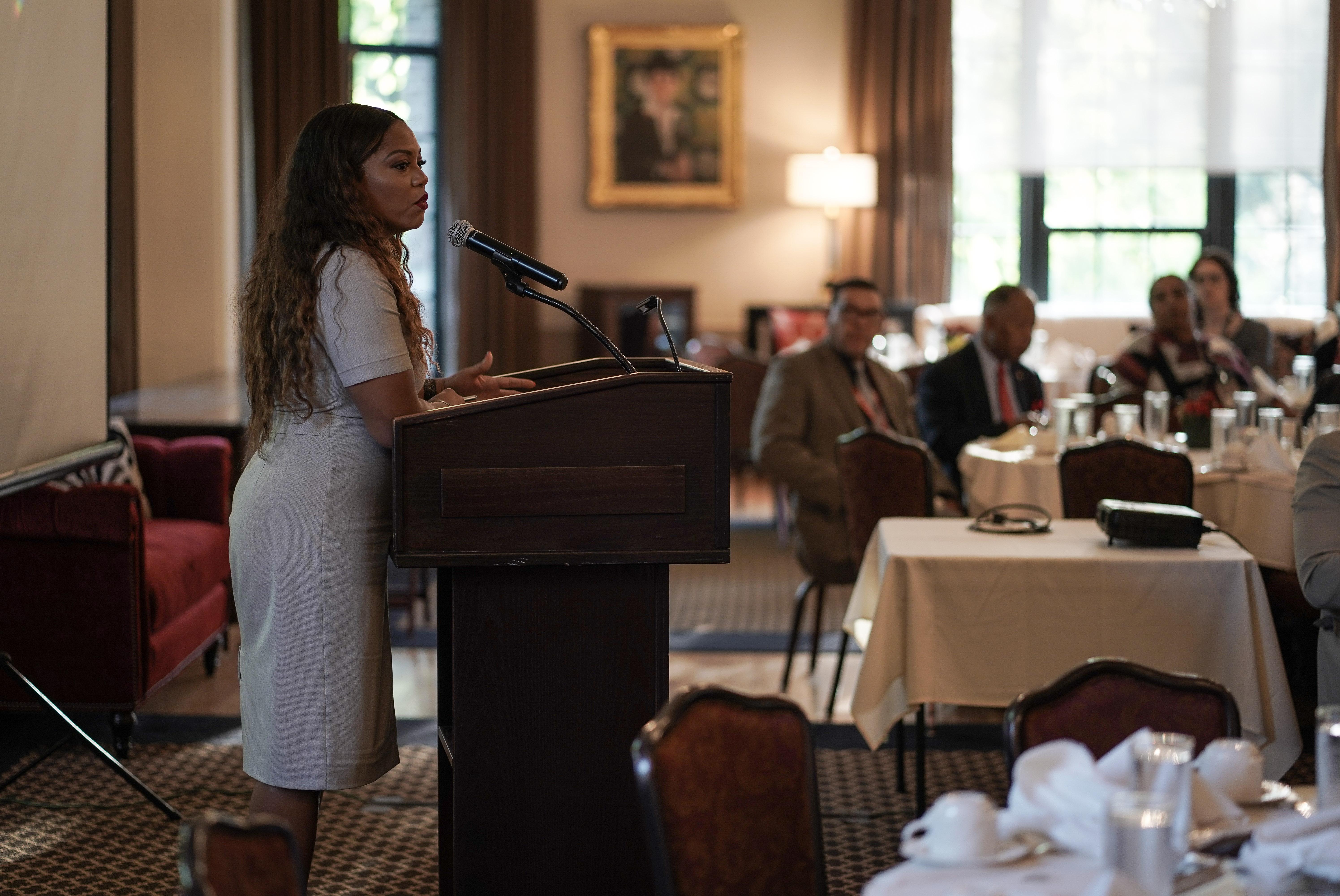 African American women speaking at podium