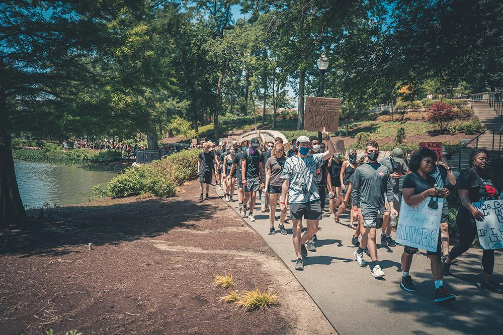 protesters march along Mirror Lake at Ohio State university