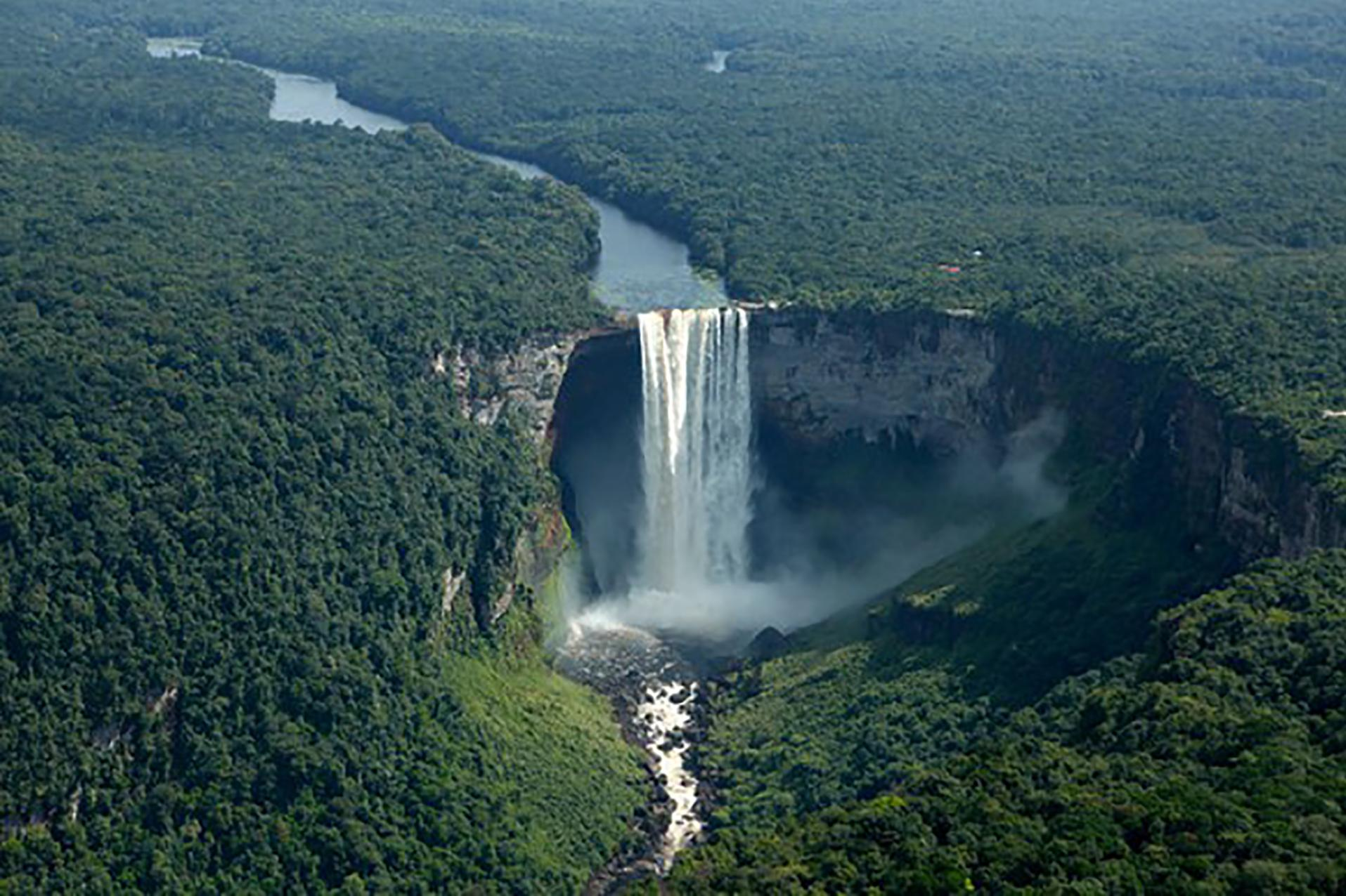 Large waterfall in middle of rain forest in Guyana.