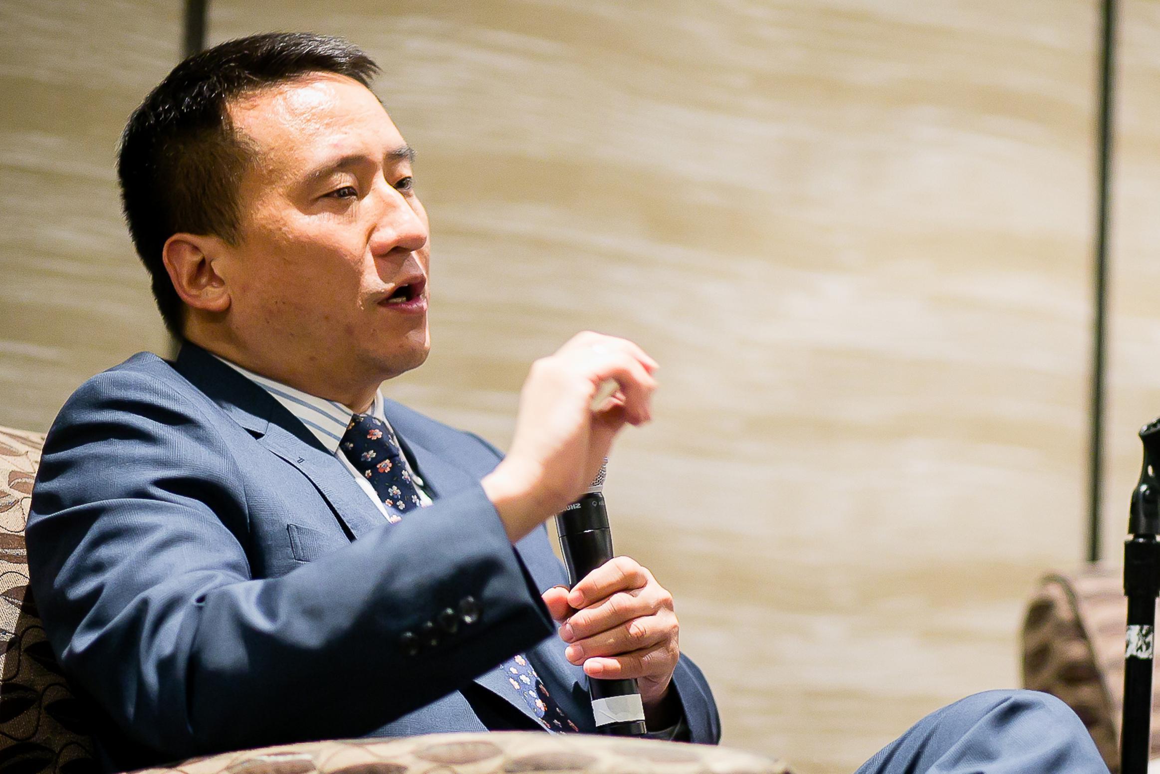 Jason Wu sitting in a chair talking