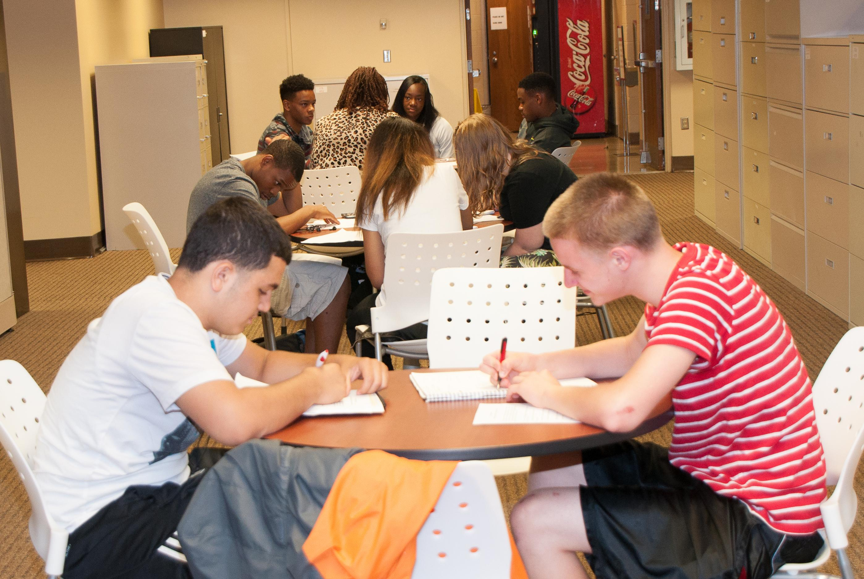 Two students working at a table