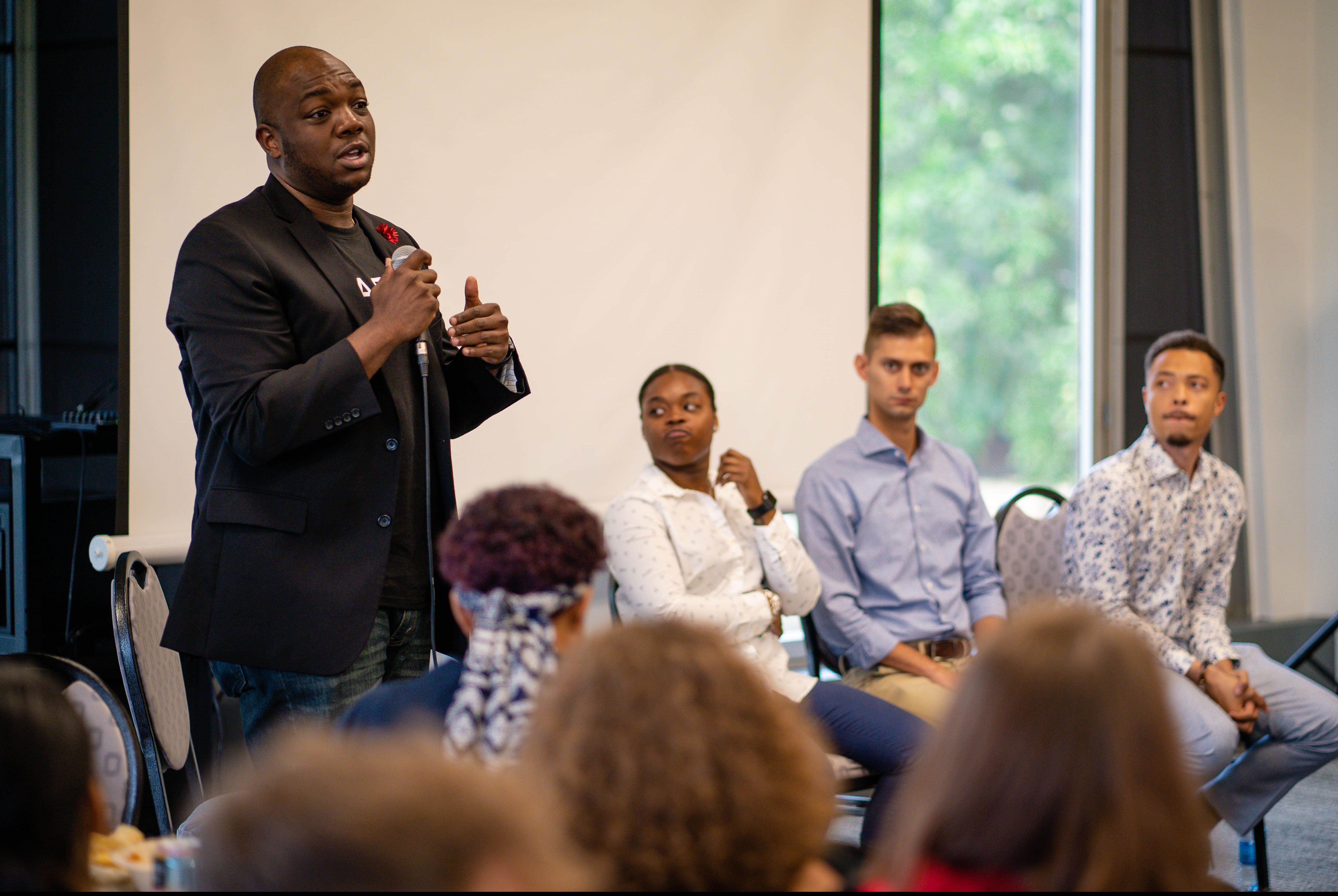 Man speaking with students