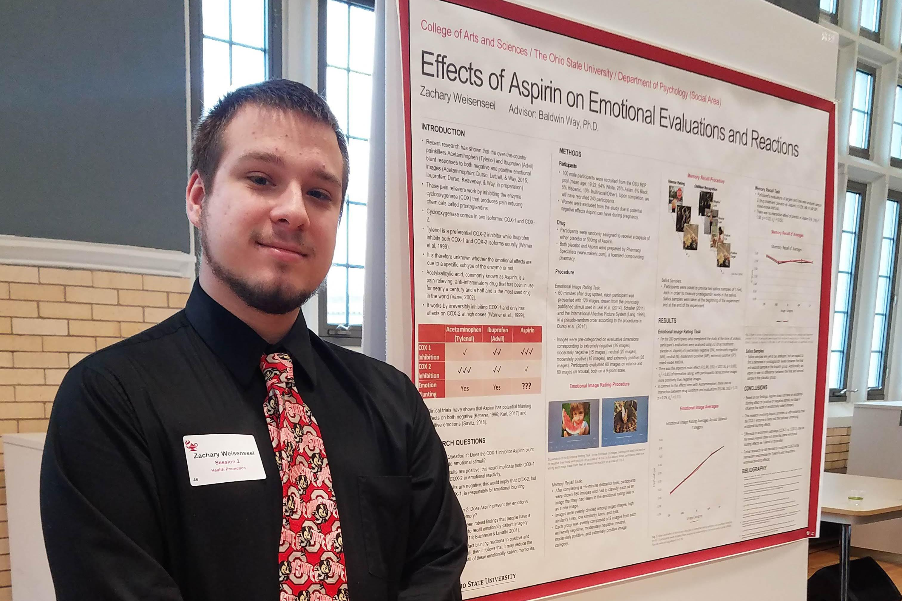 Zachary Weisensell in front of a science poster presentation