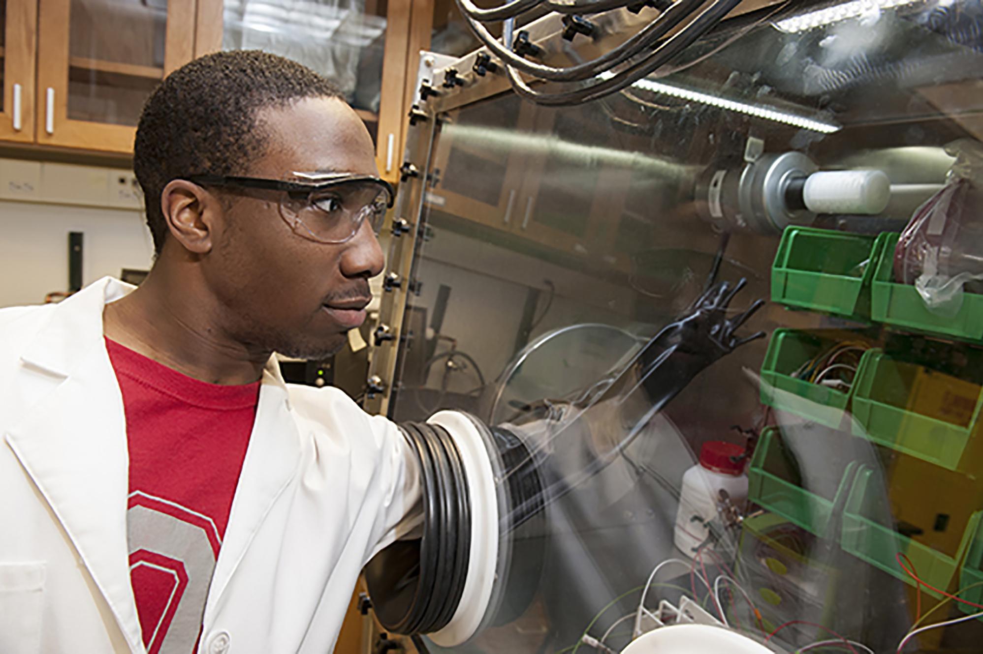 Black male doing scientific research in a lab
