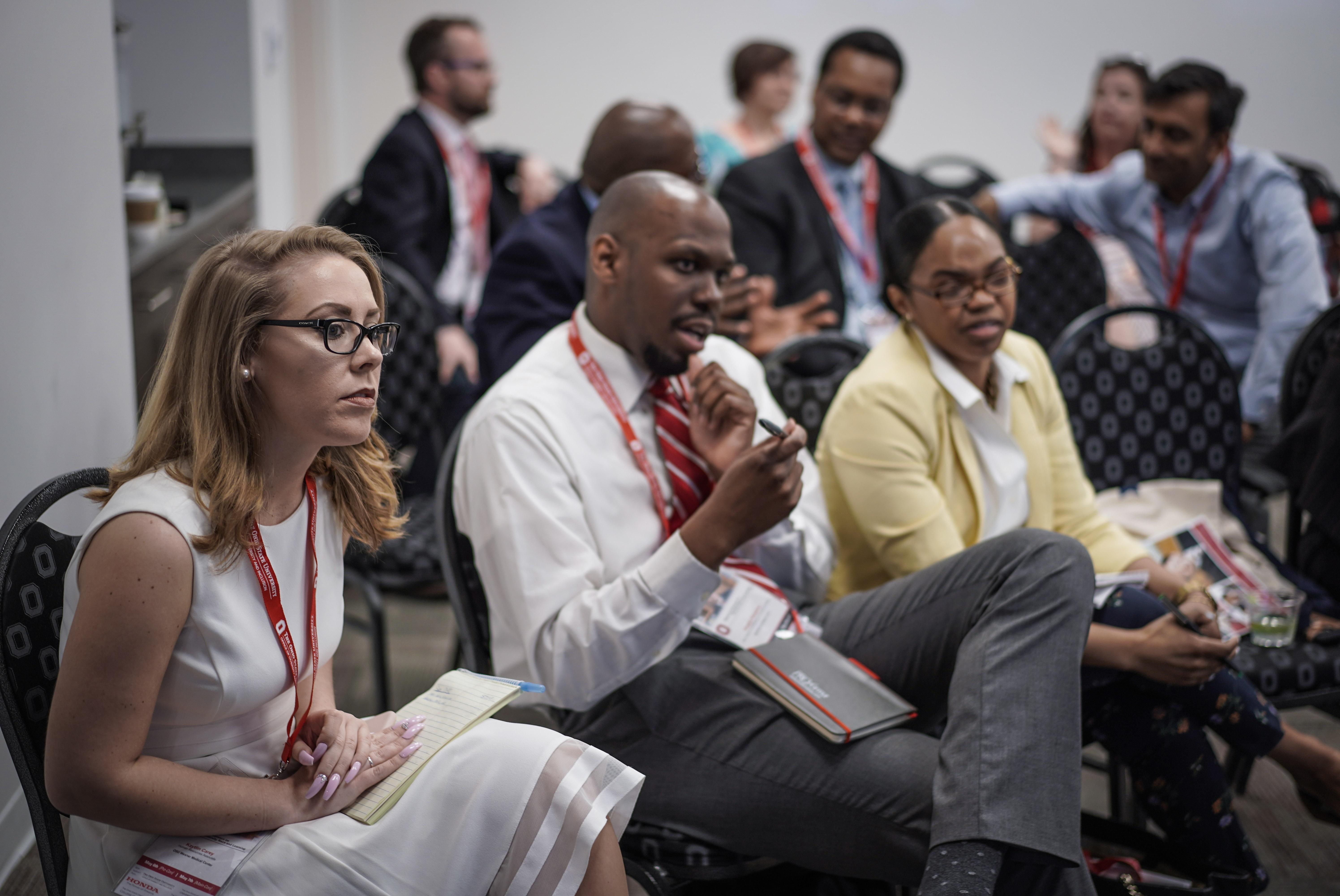 Participants listen to speaker
