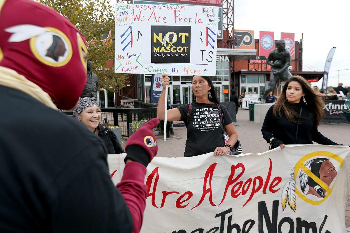 Protesters protesting use of Washington Redskins logo while counterprotesters point at them