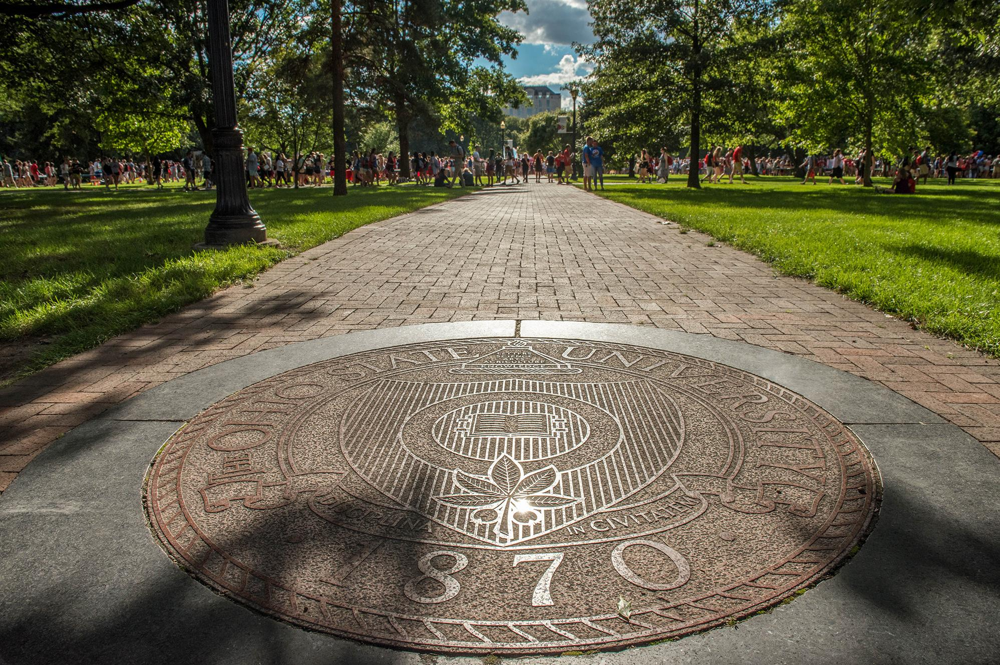 PHoto of OHio State University seal on the oval