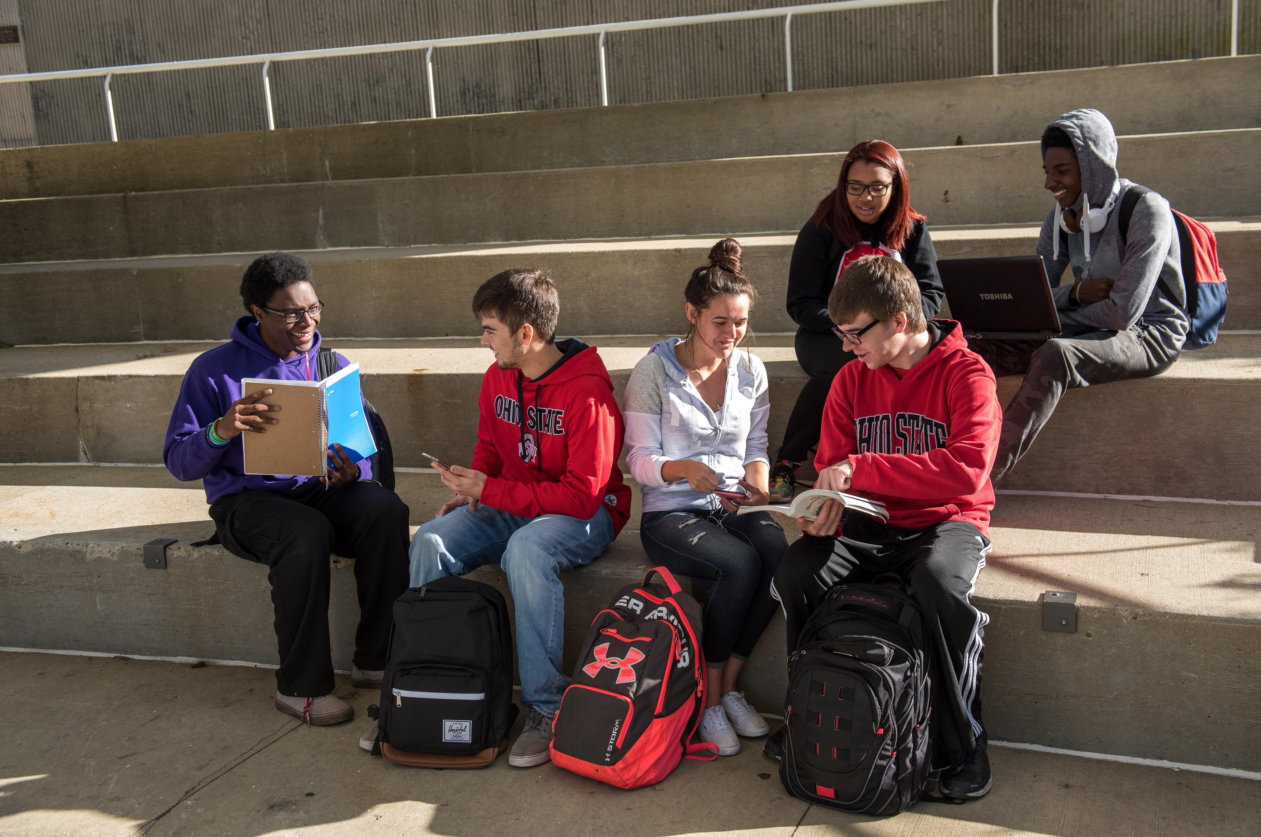 Group of students studying by Mirror Lake